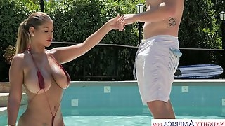 Awesome seductress in bikini Bridgette B seduces her neighbor by the poolside