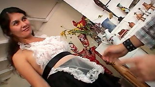 Mature maid plays with her hairy pussy before giving head