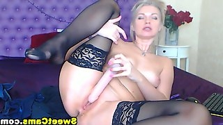 Horny blonde dress in a very sexy lingerie as she begins to tempt and lure he viewers