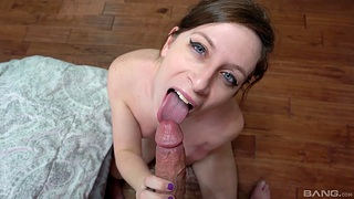 Brunette inclusive Shelby Paris drops on the top of her knees to give a blowjob